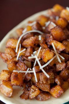Parmesan Roasted Potatoes: Place 4 c (3/4 in) cubed Yukon gold potatoes in greased baking dish and toss together with... 3 T olive oil, 1 t garlic salt, 1/2 t salt, 2 t paprika, 1 t pepper, 4 T parmesan cheese. Bake at 425 for 30 minutes, toss, return to over for another 15-25 min until crispy