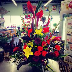 #Bright and #bold #tropical #floral #arrangement !! #Ginger #glads #roaes #gerbera #orchid #lilies ! So #fun and #funky !!