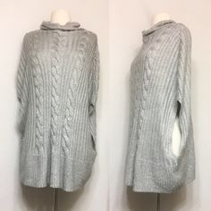 Vera Wang Oversized Tunic Sweater Very unique sweater! Perfect over a fitted long sleeve shirt and skinny jeans or leggings. Fabric has a shimmery effect that sparkles in the light. 77% polyester, 22% acrylic. Length: 29 inches Simply Vera Vera Wang Sweaters
