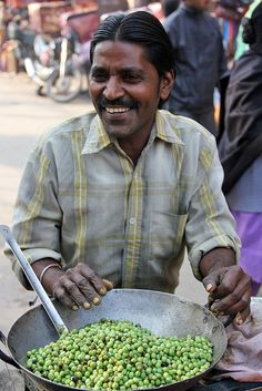 Street Food: The Green Pea Man of Varanasi - A pile of carefully heated green peas is served in a little cone formed from a stack of fresh leaves. Added to that are a few scoops of masala spices, some chili flakes, a dash of salt, fresh chopped red onions, and a squeeze of lime.