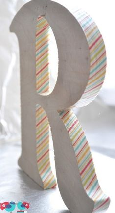 washi tape on wooden letters - would love a brown/gray antiqued stain and old music or writing on the sides :)