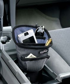 The High Road Driver Cup organizer fits in the car cup holder. It has fleece-lined pockets for holding your sunglasses, phone, player, and other small items. Keeps items handy and easy to reach while driving. Cord port on the back for plugs and chargers. Subaru, Car Console, Center Console, Honda, Walpaper Black, Car Accessories For Girls, Travel Accessories, Auto Accessories, Car Holder