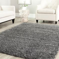 @Overstock - This power-loomed cozy solid shag rug offers luxurious comfort and easy-to-design styling. High-density polypropylene pile features a dark grey background and provides one of the most plush feels available in a rug.http://www.overstock.com/Home-Garden/Safavieh-Cozy-Solid-Dark-Grey-Shag-Rug/7322535/product.html?CID=214117 $59.99