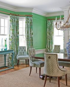 Green walls in the dining room and tufted Ritz Dining Chairs from the Thomas Pheasant Collection   Baker Furniture
