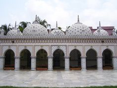 This beautiful mosque in Dhaka, Bangladesh is a classical example of Mughal architecture. Its 5 domes are decorated all over with hundreds of shinning blue stars set in white marble. From distance the glittering stars give an impression of a starry sky. The walls of the mosque,are decorated with mosaic containing small pieces of Chinaware. This type of mosaic is called 'Chini Tikri' work. The mosque known as Tara (star) Masjid was built in early 18th century and originally had 3 domes.