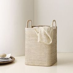 Modern Weave Basket -made of tightly-woven rattan and hapao, with a whitewashed finish from west elm