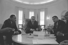 L - R: Rev. Martin Luther King, Jr., President Lyndon B. Johnson, Whitney Young, and James Farmer.