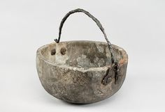 """Hanging vessel from the Viking age. Soap stone and iron. Grave find Björkö, Sweden. Object from the exhibition """"We call them Vikings"""" produced by The Swedish History Museum."""