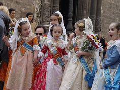 "Cavalier, Valencia, Spain: ""Girls in historical Valencian costume"" taken 4 April 2005 by Tom Adrianssen. Perfect from the tips of their Valenciennes lace-covered heads to the tips of their brocade-shod toes. The pinned coils of hair, the triple-drop earrings, the pendants on ribbon, the bodices! the aprons! The sashes (on men it would be baldrics). These girls NAIL it!"