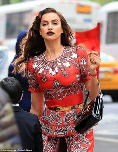 Lady in red: Irina looked glamorous as she stunned on the set of a Vogue magazine photo shoot on Tuesday in New York City's Central Park
