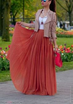 Dark Coral pleated maxi skirt, White lace trimmed tank, Beige biker jacket | Pink large clutch, Gold bangle, Beaded necklace