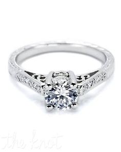 Convey modern romance with a classic solitaire diamond engagement ring on a romantic, swirling heart setting. This ring features filigree details, an intricately bejeweled carriage and pave-set diamond shoulders with signature Tacori design details. Matching band style is 2553.