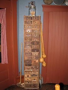 Cubby made from old cigar boxes and spools for knobs