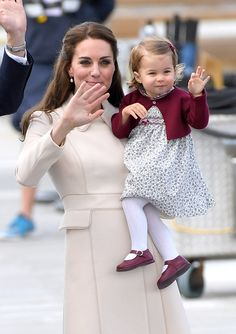 Catherine, Duchess of Cambridge and Princess Charlotte wave to well wishers as they depart Victoria after their Royal Tour of Canada on October 1, 2016 in Victoria, Canada