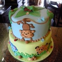 shower cake inspired by the Fisher Price jungle animal theme.Baby shower cake inspired by the Fisher Price jungle animal theme. Torta Baby Shower, Safari Baby Shower Cake, Baby Shower Cake Pops, Boy Baby Shower Themes, Baby Shower Fun, Fun Baby, Zoo Cake, Jungle Cake, Jungle Theme