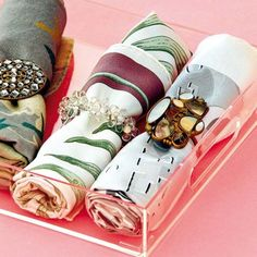 clever way of keeping your scarves rolled when not in use - napkin rings.