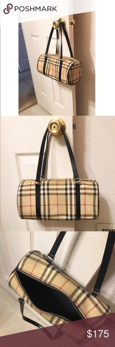 AUTHENTIC Burberry Barrell Handbag Great condition, a few small black marks on bag, and handle is peelin' a lil. But no major flaws! Burberry Bags Shoulder Bags