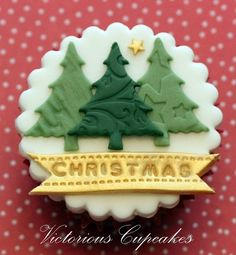 I just like the idea of Christmas tree cookies with another design on top...neat! :)