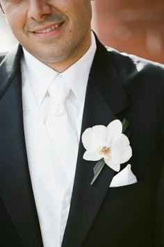 Perfect white orchid boutonnière for groom