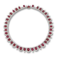 Designed as a single row of graduating floral clusters suspended from a line of round diamonds, the whole set with 38 cushion-shaped rubies weighing approximately 60.00 carats and 257 round diamonds weighing approximately 39.75 carats, mounted in platinum and gold, length 16 inches.