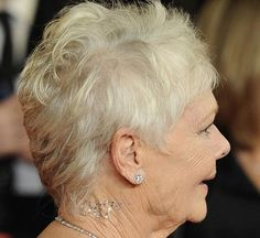 Dame Judi Dench wears 007 Dior Skin bling