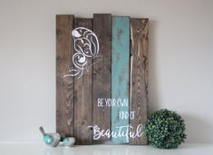 Be your own kind of Beautiful  How inspiring are those words?? The beautiful butterfly adds a touch of elegance. This sign measures 17 X 24 and is stained in a dark walnut, teal stripe on one of the boards and distressed for that rustic charm then hand painted in ivory/white lettering. I am able to change the color of the stripe if you desire, please just send me a message.  All of my signs are made from reclaimed wood or repurposed wood. With using materials such as reclaimed wood, they…
