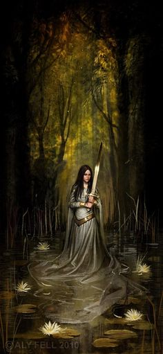 Forest protector. . .I love the way her dress falls and floats in the water.