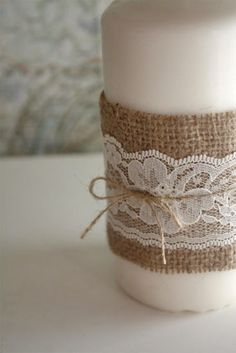 lace and burlap wrapped candle . beautiful for wedding reception