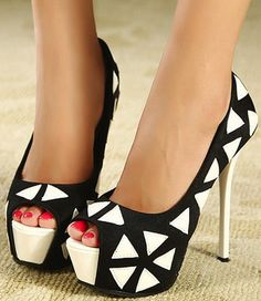 Sexy black and white pumps. Peep toe opening, red nails, geometric print.