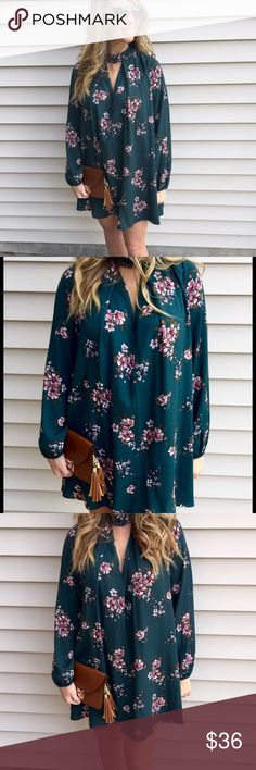 Forest Green Floral Dress This forest green dress features a front keyhole with button, cuffed sleeves and an all over floral print. Pair this dress with your favorite boots or sandals to create the perfect look.   -100% Rayon  -Wearing size small Dresses Mini