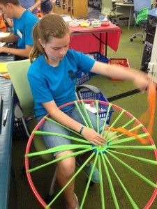 Hula Hoop Weaving | I especially like that the finished product is both used as decor, and then storytime mats.