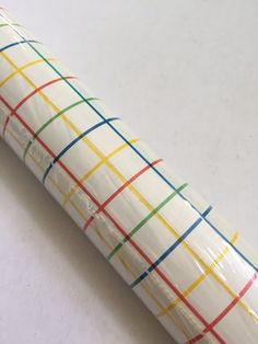 candy stripe plaid contact paper drawer liner shelf paper craft supply etc. red yellow blue green by Rubbermaid  - DETAILS - Closet Cool + Shelf Stellar! durable + washable + self adhesive  - CONDITION = NOS original unopened packaging  - MEASUREMENTS - 10 square feet - 3.33 yards x 12 (each roll)  Shop all of our modern vintage https://www.etsy.com/shop/goodluxe