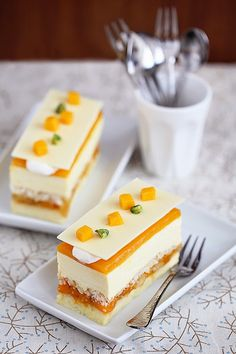 Lumiere Exotic Cake - layers of cheesecake, fruit, white chocolate mousse, mango & passionfruit jelly with rum syrup. Gourmet Desserts, Fancy Desserts, Delicious Desserts, Yummy Food, Sweet Recipes, Cake Recipes, Dessert Recipes, Mini Cakes, Cupcake Cakes