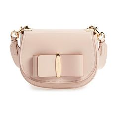 Anna vara leather crossbody bag by Salvatore Ferragamo. Polished logo hardware anchors a signature bow on a compact, calfskin-leather shoulder bag cut in a classic saddle si...