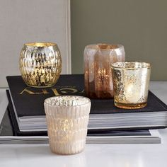 Mercury candleholders from West Elm $5 (use to plant succulents)
