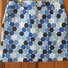 Talbots Geometric Print Mini Skirt Talbots Geometric Print Mini Skirt.  This preloved skirt is made of 97% cotton, 3% spandex for added comfort.  Skirt offers a ftont zip wirh 2 functional front pockets with buttons.  This skirt is thick enough as to not require a slip. Talbots Skirts Mini