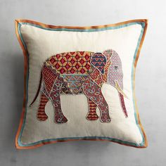 Our patchwork pachyderm pillow is crafted with metallic thread glass beads and a multicolor border for extra brilliance. Elephant Home Decor, Elephant Trunk, Elephant Crafts, Elephant Throw Pillow, Throw Pillows, Cushion Embroidery, Hand Work Blouse Design, Indian Pillows, Patchwork Cushion