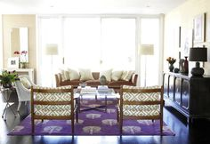 Chic living room design with David Hicks La Fiorentina fabric upholstered mid-century modern chairs, purple rug, white cane chairs, mauve velvet sofa, black Hollywood regency cabinet and tan grasscloth wallpaper. Living Room Shelves, Chic Living Room, Living Room Decor, Living Room Designs, Living Spaces, World Decor, Transitional Living Rooms, Mid Century Chair, Interior Decorating