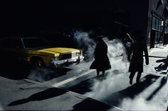 Pedestrians crossing a New York street in winter time cast long shadows, 1980 Ernst Haas
