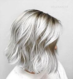 From white hot platinum to smokey dark grey, the silver hair color trend is here and not going anywhere anytime soon. Dive on in and see which of these sexy shades suits you best!