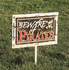 Our Beware Of Pirates Yard Sign will bring high sea adventure to your pirate party decor. This plastic sign measures 19 inches wide  x 23 1/2 inches high when attached to the wooden stake.