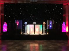 The giant set up including flame effects - star cloth back drop - up lighting and the spinning disco balls