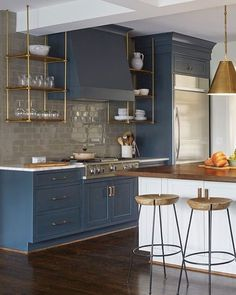 Painted cabinetry FTW! How gorgeous is this deep blue paired with the brass open shelves?! ✨Check out our Pinterest page to see more spaces that will inspire a cabinetry and hardware refresh.✨ [design: @mariannestrong, : @jallsopp] #LinkInProfile #NowPinning