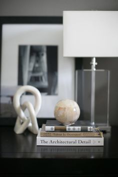 small shop by Erika Brechtel for Style Me Pretty photo by Bryce Covey bedroom nightstand his vignette crystal block lamp black white architectural photo books