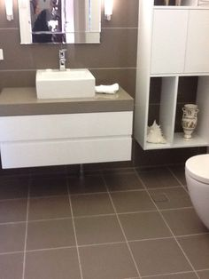 Client didn't just want storage in the guest bathroom she designed the open shelf's to had interest