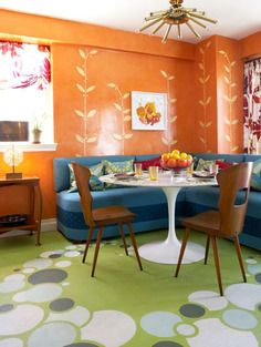 Colorful, vintage decor. That table is available in store right now, and we have similar sputnik lighting