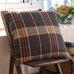 """Bring a touch of rustic charm to your guest bedroom or master suite with this handsome cotton pillow, showcasing an earth-toned plaid motif and goose feather-down insert.    Product: Pillow Construction Material: 100% Cotton fiber cover, batting and goose feather-down fill Color: Brown, cream and sage   Features: Insert included      Dimensions: 21"""" x 21""""   Cleaning and Care: Machine wash cold and line dry"""