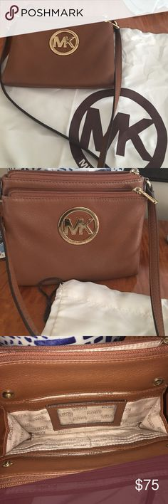 Michael Kors Crossbody Gently used MK crossbody bag! Great for traveling or going out!! Used but very good condition, only blemishes include some hard to notice scratches on the MK emblem. KORS Michael Kors Bags Crossbody Bags
