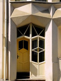 This corner apartment block was constructed between 1913 and 1914 by František Hodek, and is generally attributed to the cubist architect Josef Chochol. http://praguestory.com/