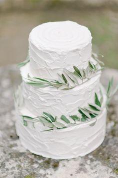 wedding cake with eucalyptus - photo by Nadia Meli http://ruffledblog.com/a-romantic-tuscany-elopement-workshop